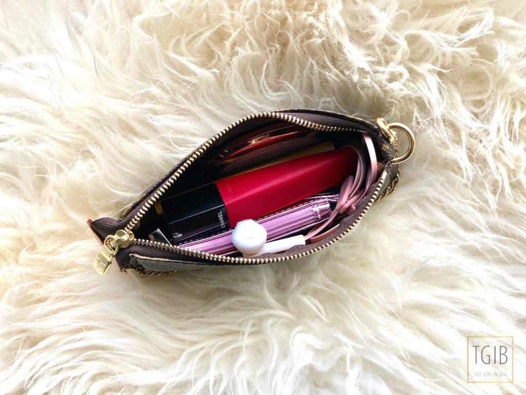 Louis Vuitton Mini Pochette Accessoires filled with items