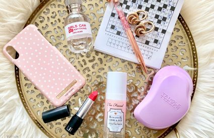 flatlay with puzzle, perfume, kyliecosmetics
