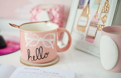 pink mug with hello desk